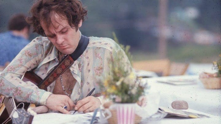Tim Hardin Jotting Some Notes Or Writing A Song While At Woodstock