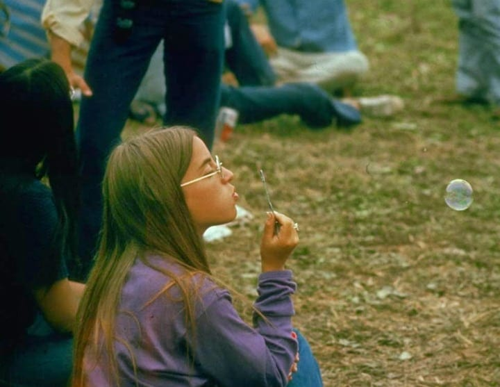 Jackie Barg Blowing Bubbles at Woodstock