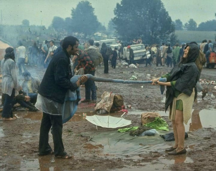 Couple at Woodstock Squeezing Water Out of Blanket