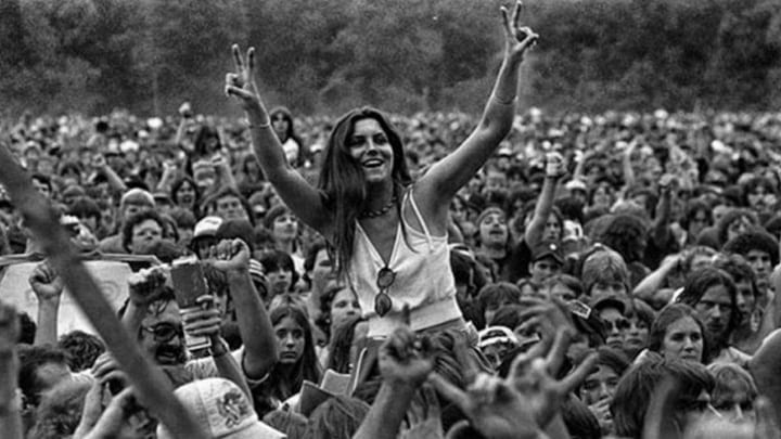 A Girl Enjoying The Show On The Shoulders Of A Friend at Woodstock