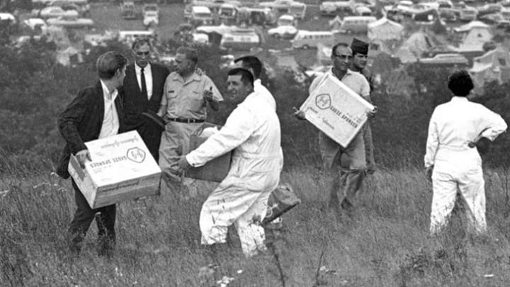 Workers Carry Medical Supplies at Woodstock